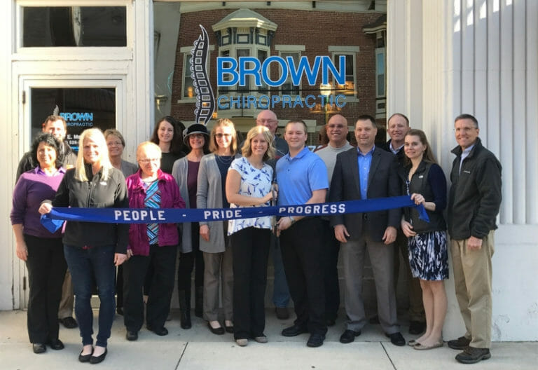 Darke County Ohio Chiropractor - Opening day of office outside banner representatives